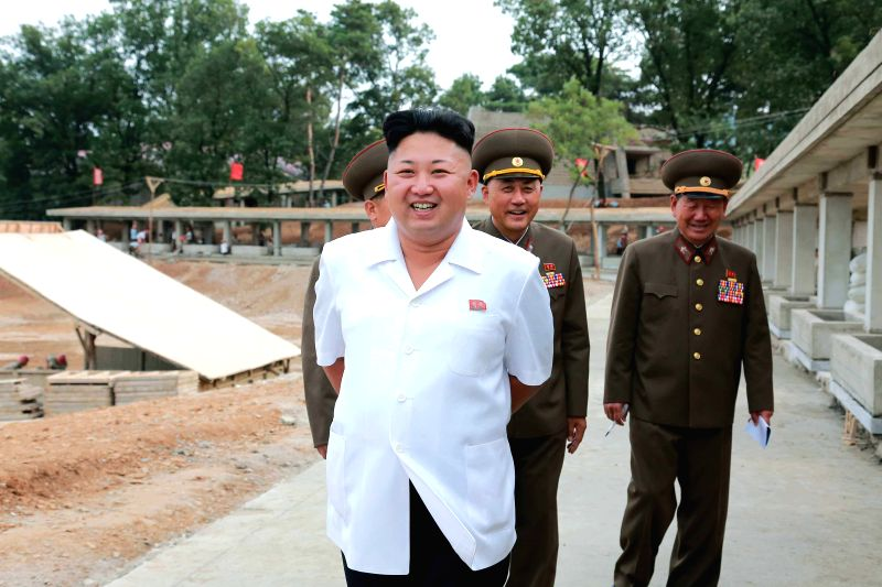 The photo provided by KCNA on Aug. 18, 2014 shows top leader of the Democratic People's Republic of Korea (DPRK) Kim Jong Un (front) giving field guidance to the .
