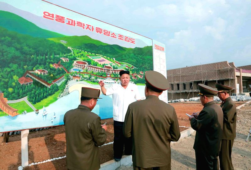 The photo provided by KCNA on Aug. 18, 2014 shows top leader of the Democratic People's Republic of Korea (DPRK) Kim Jong Un (2nd L) giving field guidance to the .