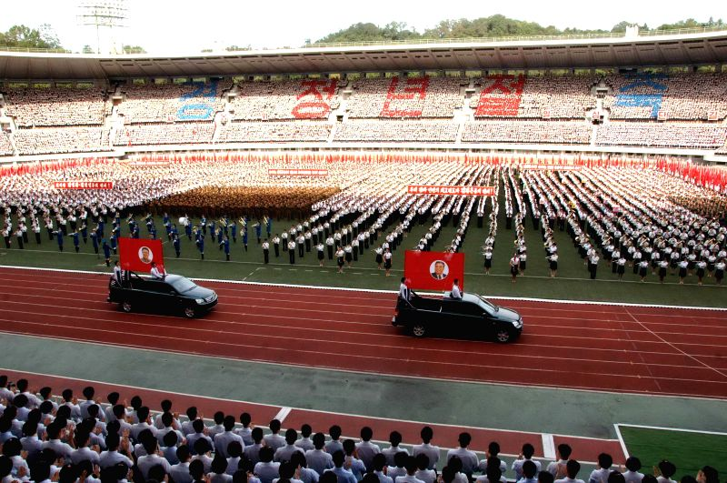 Photo provided by Korean Central News Agency (KCNA) on Aug. 27, 2014 shows a meeting and grand march of members of the young vanguard taking place at the Kim Il ..