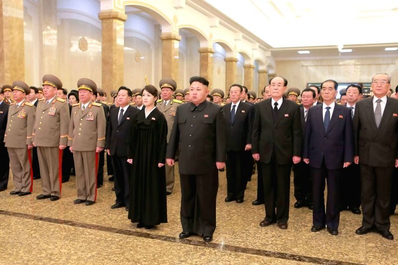 Photo provided by Korean Central News Agency (KCNA) on Dec. 17, 2014 shows populace of the Democratic People's Republic of Korea (DPRK) standing in silence as ...