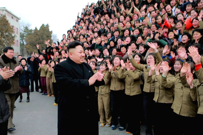 Photo provided by Korean Central News Agency (KCNA) on Dec. 20, 2014 shows top leader of the Democratic People's Republic of Korea (DPRK) Kim Jong Un (C) give ...