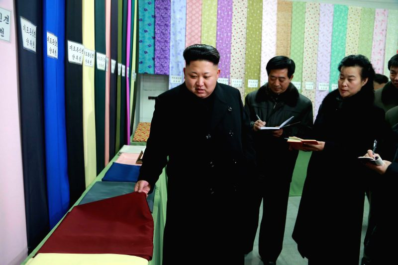 Photo provided by Korean Central News Agency (KCNA) on Dec. 20, 2014 shows top leader of the Democratic People's Republic of Korea (DPRK) Kim Jong Un (1st L) give
