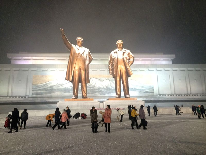 Pyongyang (DPRK): People gather at the Mansudae Grand Monument in Pyongyang, the Democratic People's Republic of Korea (DPRK), Dec. 10, 2014. Pyongyang witnessed the first snow fall in this season ...