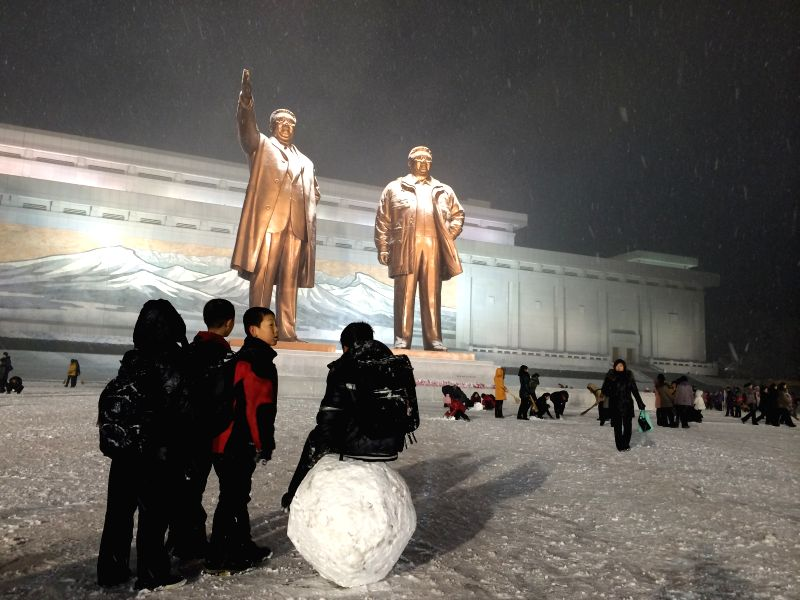 Pyongyang (DPRK): Students and youngsters sweep snow at the Mansudae Grand Monument in Pyongyang, the Democratic People's Republic of Korea (DPRK), Dec. 10, 2014. Pyongyang witnessed the first snow ..