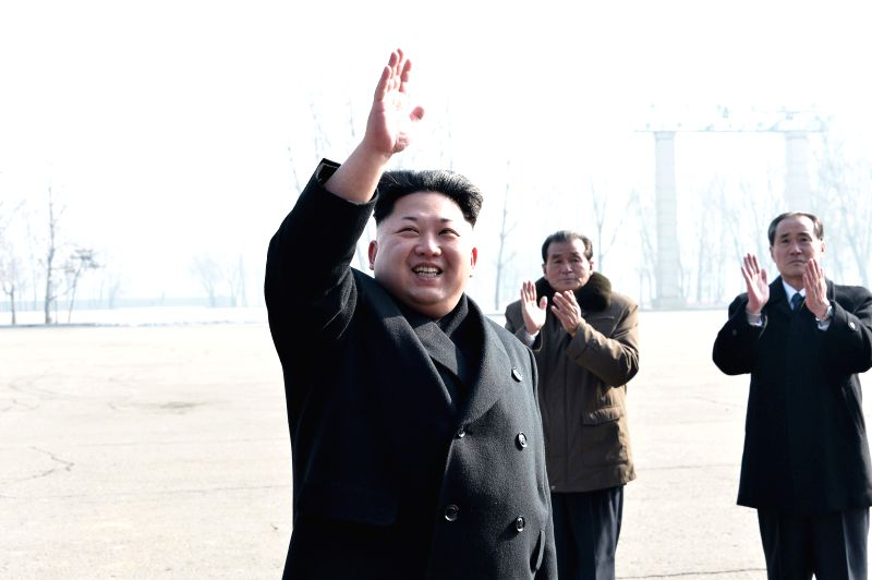 Photo provided by Korean Central News Agency (KCNA) on Feb. 12, 2015 shows top leader of the Democratic People's Republic of Korea (DPRK) Kim Jong Un (front) ...
