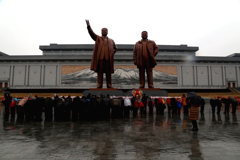 Pyongyang citizens and soldiers bow before bronze statues of former leaders Kim Il Sung and Kim Jong Il to celebrate the 73rd birth anniversary of Kim Jong Il at .