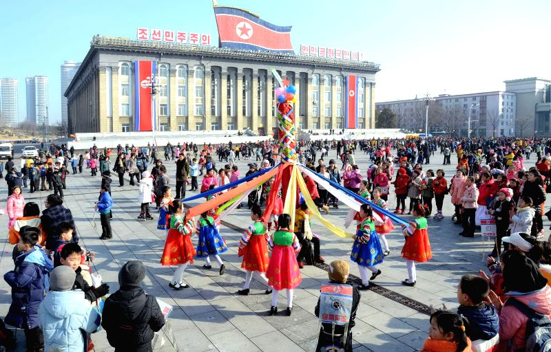 Photo provided by Korean Central News Agency (KCNA) on Feb. 19, 2015 shows children playing at Kim Il Sung Square in Pyongyang, the Democratic People's Republic ...
