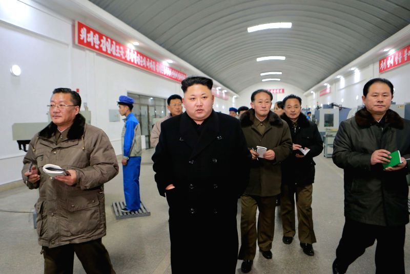 Photo provided by Korean Central News Agency (KCNA) on Jan. 16, 2015 shows top leader of the Democratic People's Republic of Korea (DPRK) Kim Jong Un (C, front) ..