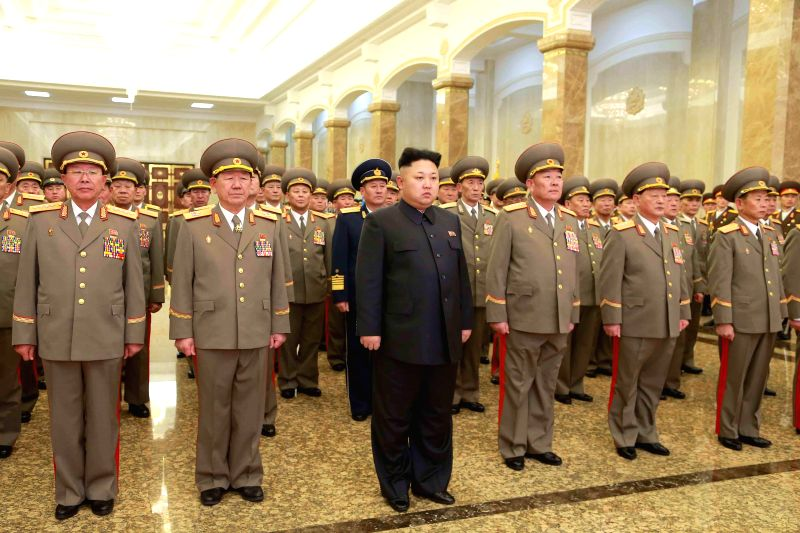 Photo provided by Korean Central News Agency (KCNA) on Jan. 1, 2015 shows top leader of the Democratic People's Republic of Korea (DPRK) Kim Jong Un (C) visiting ..