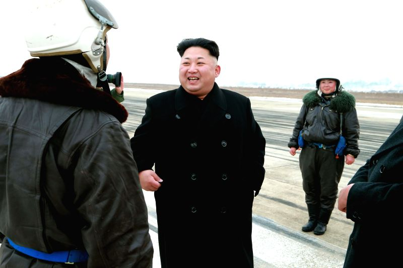 Photo provided by Korean Central News Agency (KCNA) on Jan. 24, 2015 shows top leader of the Democratic People's Republic of Korea (DPRK) Kim Jong Un (C) recently