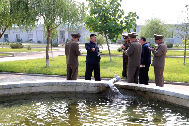 This undated photo released by Democratic People's Republic of Korea (DPRK) 's official Korean Central News Agency (KCNA) on July 17, 2014 shows DPRK top leader ..