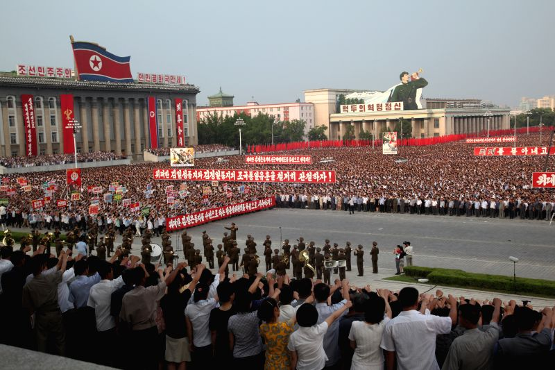 People march at Kim Il Sung Square during an assembly to commemorate the 64th anniversary of Korean War in Pyongyang, capital of the Democratic People's Republic .