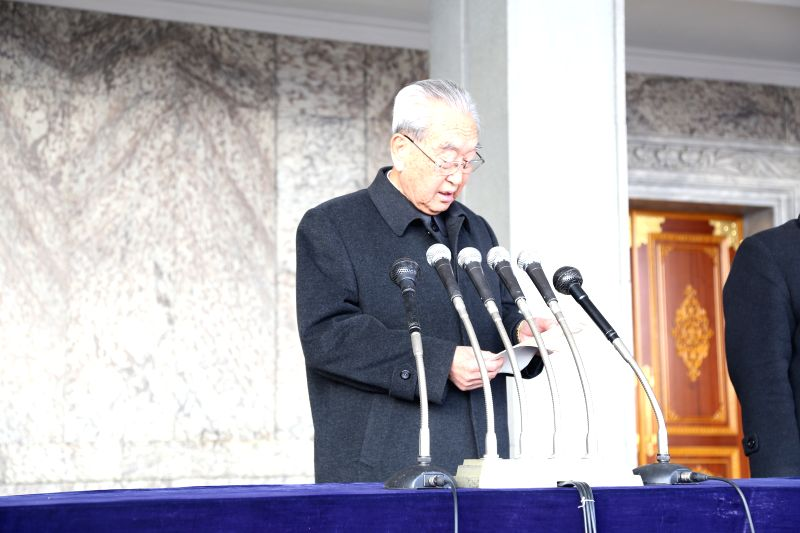 Kim Ki Nam, secretary of the Central Committee of the Workers' Party of Korea (WPK), reads a statement during a demonstration against a UN human rights resolution at Kim Il-sung Square in .