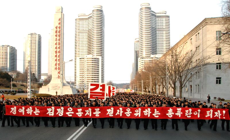 Pyongyang (Korea ): Photo provided by Korean Central News Agency (KCNA) on Nov. 27, 2014 shows members of the young vanguard attending a demonstration after a rally in Pyongyang, the Democratic ...