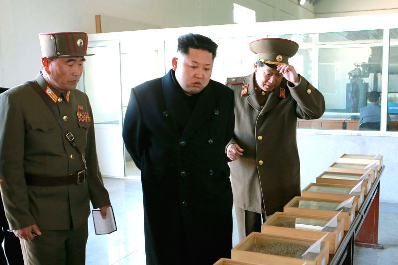 PYONGYANG, March 24 Photo provided by Korean Central News Agency (KCNA) on March 24, 2015 shows top leader of the Democratic People's Republic of Korea (DPRK) Kim Jong Un (C) giving field ...