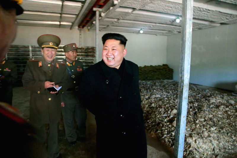 PYONGYANG, March 24 Photo provided by Korean Central News Agency (KCNA) on March 24, 2015 shows top leader of the Democratic People's Republic of Korea (DPRK) Kim Jong Un (R) giving field ...