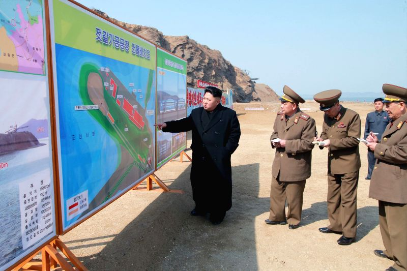Photo provided by Korean Central News Agency (KCNA) on March 27, 2015 shows top leader of the Democratic People's Republic of Korea (DPRK) Kim Jong Un (1st L) ...