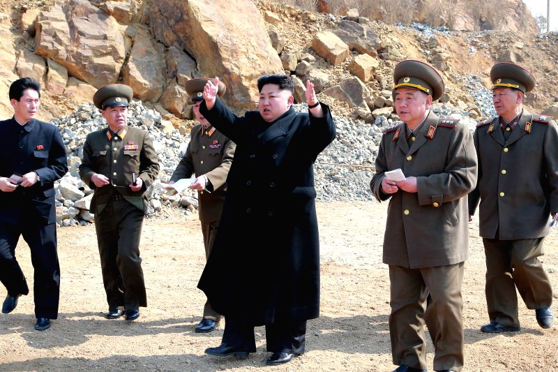Photo provided by Korean Central News Agency (KCNA) on March 27, 2015 shows top leader of the Democratic People's Republic of Korea (DPRK) Kim Jong Un (C) give ...