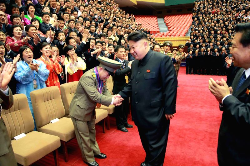 Photo provided by Korean Central News Agency (KCNA) on March 27, 2015 shows top leader of the Democratic People's Republic of Korea (DPRK) Kim Jong Un (C) ...