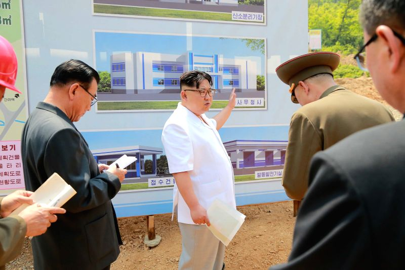 PYONGYANG, May 30, 2016 - Photo provided by Korean Central News Agency (KCNA) on May 30, 2016 shows top leader of the Democratic People's Republic of Korea (DPRK) Kim Jong Un (C) recently giving ...