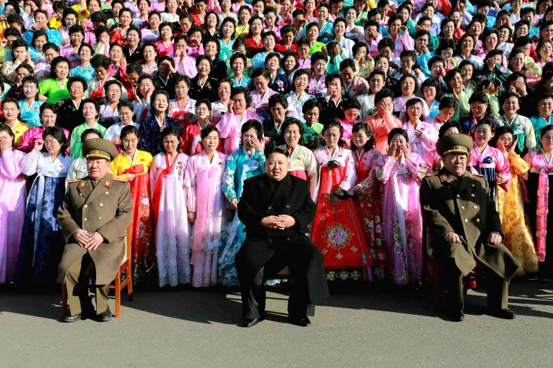 Pyongyang :Photo provided by Korean Central News Agency (KCNA) on Dec. 9, 2014 shows top leader of the Democratic People's Republic of Korea (DPRK) Kim Jong Un (C front) having a photo session with ..