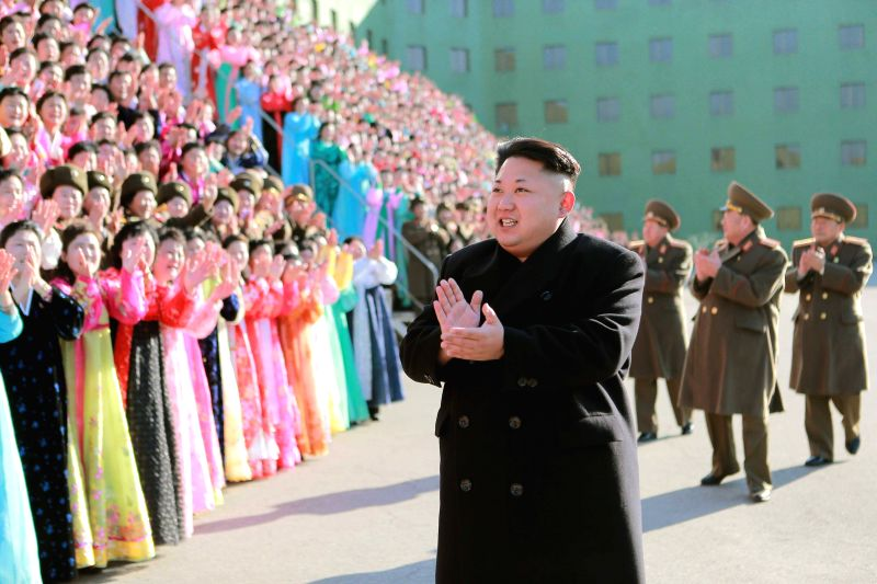 Pyongyang :Photo provided by Korean Central News Agency (KCNA) on Dec. 9, 2014 shows top leader of the Democratic People's Republic of Korea (DPRK) Kim Jong Un (front) applauding in front of the ...