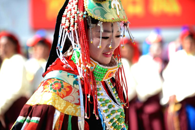 Photo taken on March 26, 2015 shows a woman wearing Kamba costume in Qamdo Prefecture, southwest China's Tibet Autonomous Region. Kamba costumes are particular ...