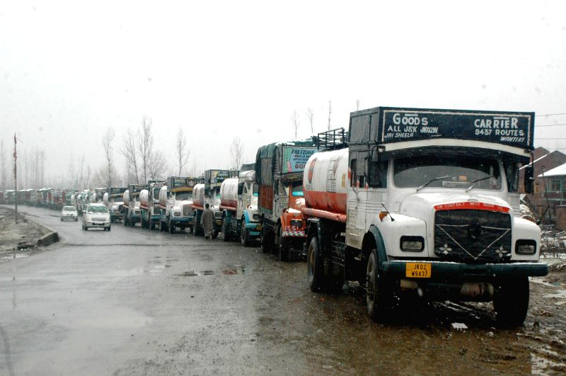 Trucks remain stranded on Srinagar-Jammu national highway as the authorities close down the highway for vehicular traffic after snowfalls in the valley on Feb 19, 2015.