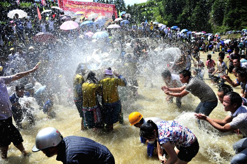 "People play in the water during the  ""Naoyu"" Festival in Congjiang County in Qiandongnan Miao and Dong Autonomous Perfecture, southwest China's ..."