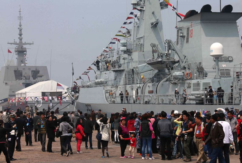 People visit the naval ships at the Dagang Port in Qingdao, east China's Shandong Province, April 22, 2014. Chinese and foreign naval ships taking part in a ...