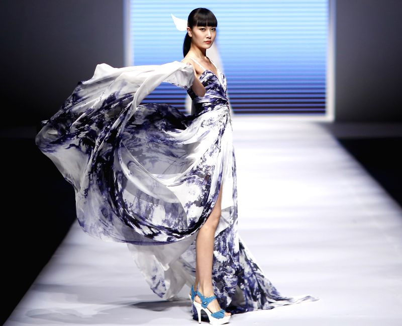 A model presents a creation during a show of Qingdao International Fashion Week in Qingdao, east China's Shandong Province, April 24, 2015. (Xinhua/Chen ...