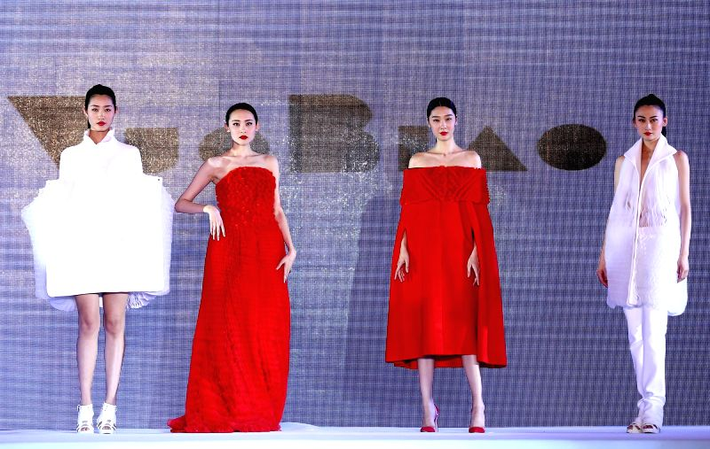 Models present fashion creations during a show of Qingdao International Fashion Week in Qingdao, east China's Shandong Province, April 24, 2015. (Xinhua/Chen ...