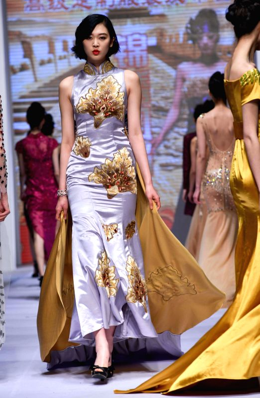 Models present creations during the 2014 China (Qingdao) International Fashion Week in Qingdao, east China's Shandong Province, April 28, 2014. The five-day ...