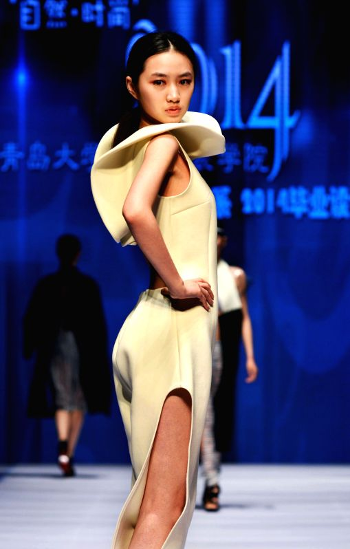 A model presents a creation designed by a graduate from Qingdao University during the Qingdao International Fashion Week in Qingdao, east China's Shandong ...