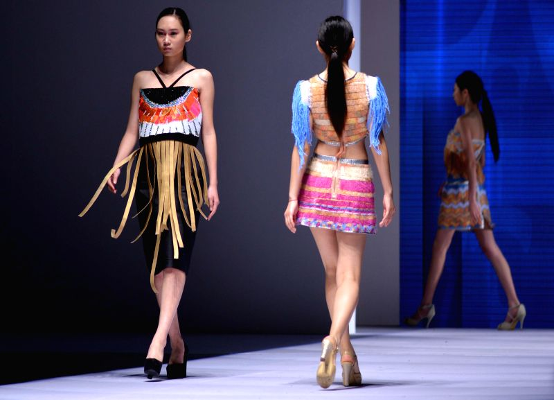Models present creations designed by graduates from Qingdao University during the Qingdao International Fashion Week in Qingdao, east China's Shandong Province, ...