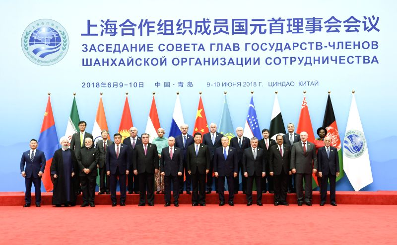 QINGDAO, June 10, 2018 - Chinese President Xi Jinping (6th R, front) poses for a group photo with other leaders and guests ahead of the 18th Meeting of the Council of Heads of Member States of the ...