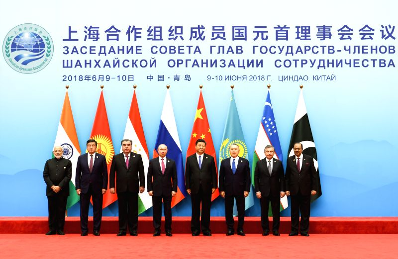 QINGDAO, June 10, 2018 - Chinese President Xi Jinping (4th R) and other leaders of Shanghai Cooperation Organization (SCO) member states pose for a group photo during a restricted session of the 18th ...