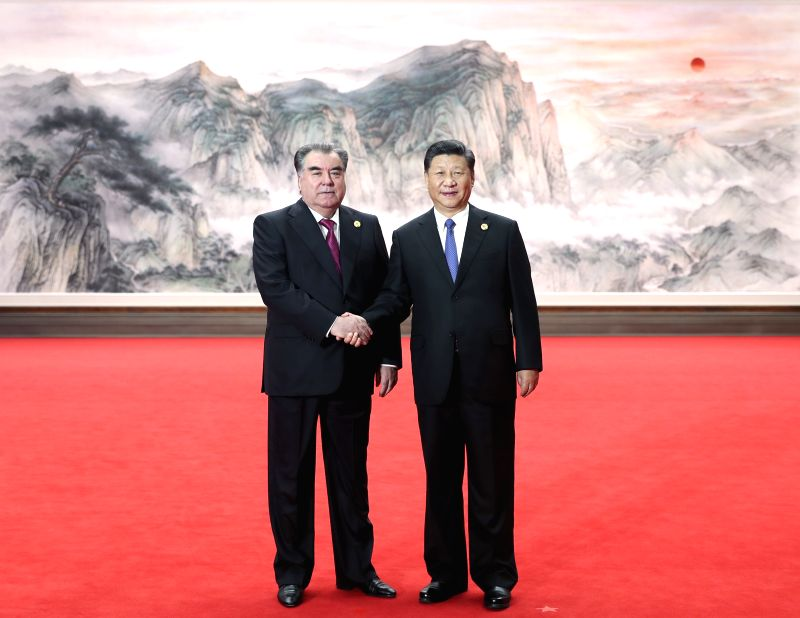 QINGDAO, June 10, 2018 - Chinese President Xi Jinping (R) shakes hands with Tajik President Emomali Rahmon ahead of a restricted session of the 18th Shanghai Cooperation Organization (SCO) summit in ...
