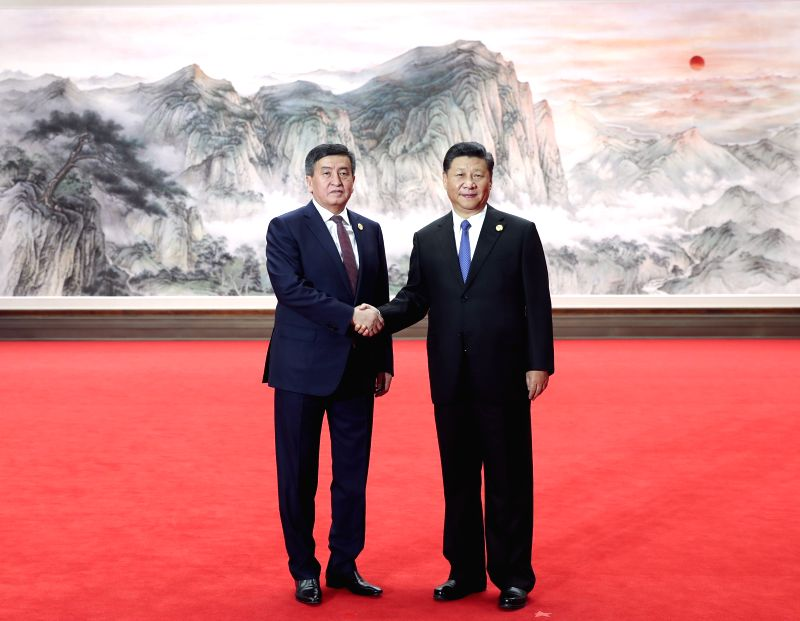 QINGDAO, June 10, 2018 - Chinese President Xi Jinping (R) shakes hands with Kyrgyz President Sooronbay Jeenbekov ahead of a restricted session of the 18th Shanghai Cooperation Organization (SCO) ...