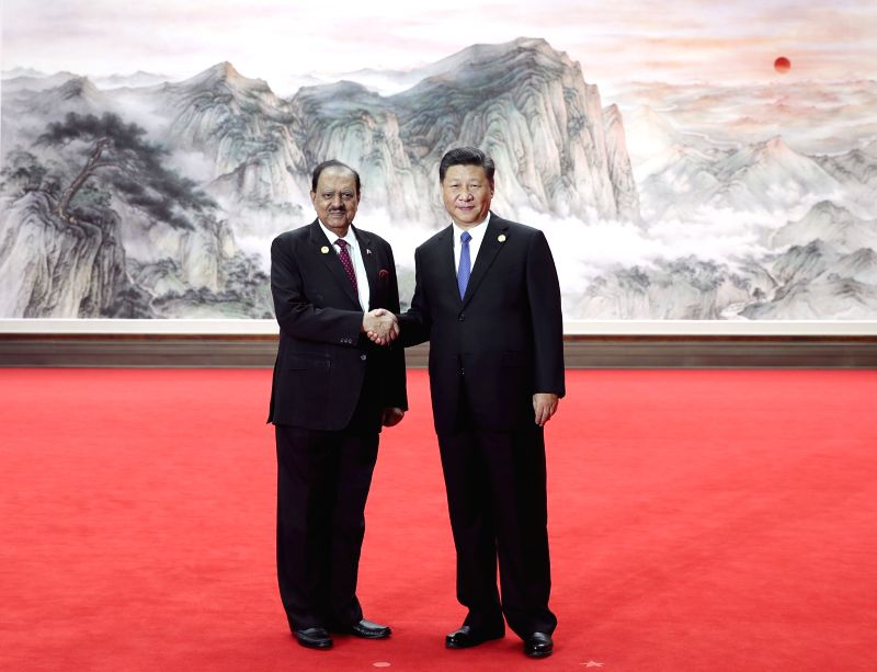 QINGDAO, June 10, 2018 - Chinese President Xi Jinping (R) shakes hands with Pakistani President Mamnoon Hussain ahead of a restricted session of the 18th Shanghai Cooperation Organization (SCO) ...