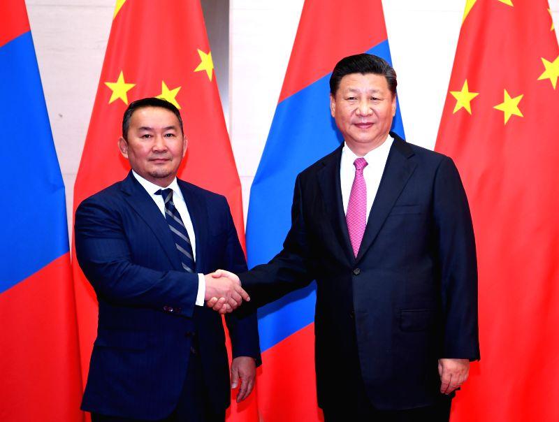 QINGDAO, June 10, 2018 - Chinese President Xi Jinping (R) meets with his Mongolian counterpart Khaltmaa Battulga in Qingdao, east China's Shandong Province, June 10, 2018.