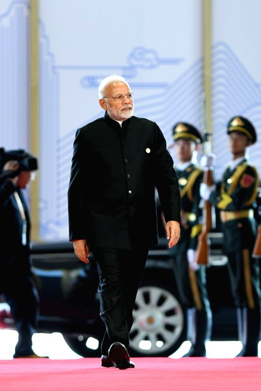 QINGDAO, June 10, 2018 - Indian Prime Minister Narendra Modi arrives for a session of the 18th Shanghai Cooperation Organization (SCO) summit in Qingdao, east China's Shandong Province, June 10, ... - Narendra Modi