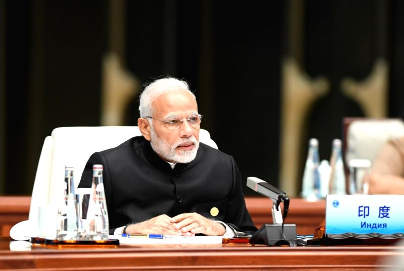 QINGDAO, June 10, 2018 - Indian Prime Minister Narendra Modi speaks at a restricted session of the 18th Shanghai Cooperation Organization (SCO) summit in Qingdao, east China's Shandong Province, June ... - Narendra Modi