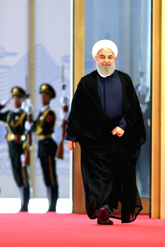 QINGDAO, June 10, 2018 - Iranian President Hassan Rouhani arrives for a session of the 18th Shanghai Cooperation Organization (SCO) summit in Qingdao, east China's Shandong Province, June 10, 2018. ... - Hassan Rouhani