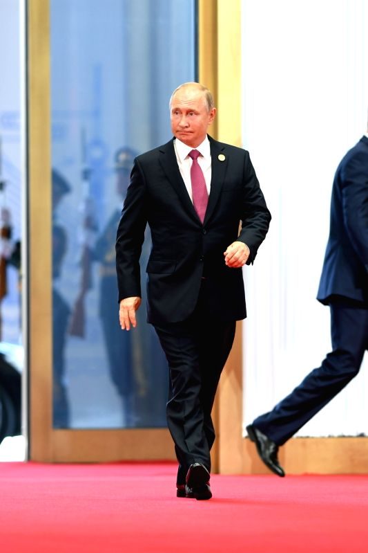 QINGDAO, June 10, 2018 - Russian President Vladimir Putin arrives for a session of the 18th Shanghai Cooperation Organization (SCO) summit in Qingdao, east China's Shandong Province, June 10, 2018. ...