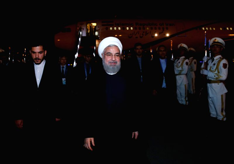 QINGDAO, June 8, 2018 - Iranian President Hassan Rouhani arrives in Qingdao, east China's Shandong Province, June 8, 2018. Rouhani is here to attend the upcoming 18th Meeting of the Council of Heads ... - Hassan Rouhani
