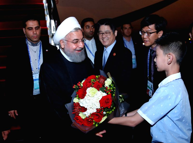 QINGDAO, June 8, 2018 - Iranian President Hassan Rouhani is greeted upon his arrival in Qingdao, east China's Shandong Province, June 8, 2018. Rouhani is here to attend the upcoming 18th Meeting of ... - Hassan Rouhani
