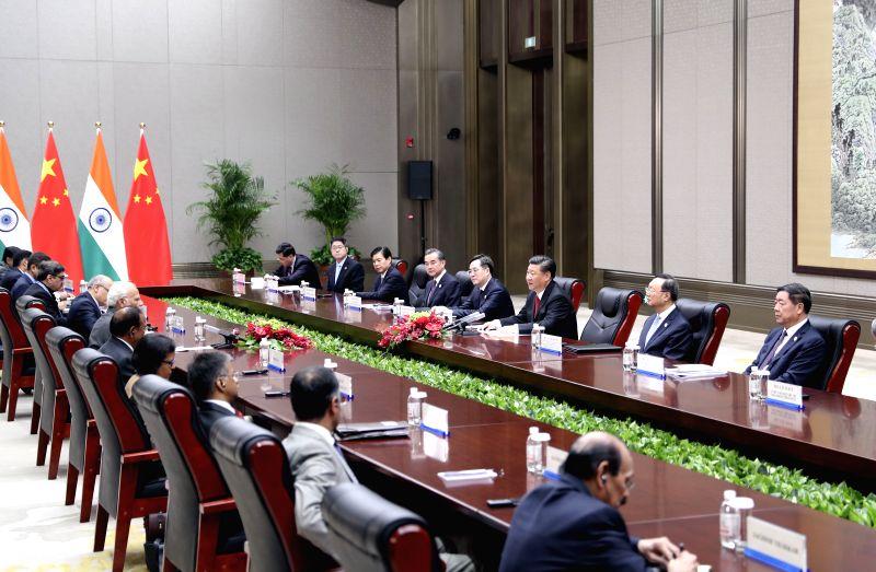 QINGDAO, June 9, 2018 - Chinese President Xi Jinping meets with Indian Prime Minister Narendra Modi in Qingdao, east China's Shandong Province, June 9, 2018. - Narendra Modi
