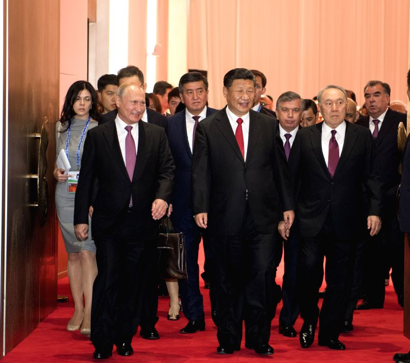QINGDAO, June 9, 2018 - Chinese President Xi Jinping (C, front) and guests attending the 18th Shanghai Cooperation Organization (SCO) summit head for a banquet in Qingdao, east China's Shandong ...