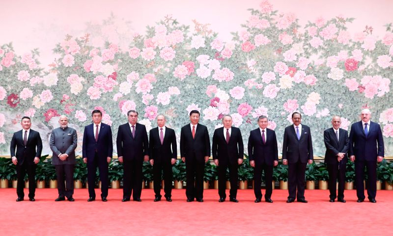 QINGDAO, June 9, 2018 - Chinese President Xi Jinping (C) and other leaders attending the 18th Shanghai Cooperation Organization (SCO) summit pose for a group photo ahead of a banquet in Qingdao, east ...